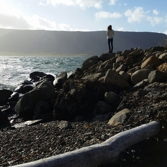Standing in awe, looking out in the West Fjords in Iceland