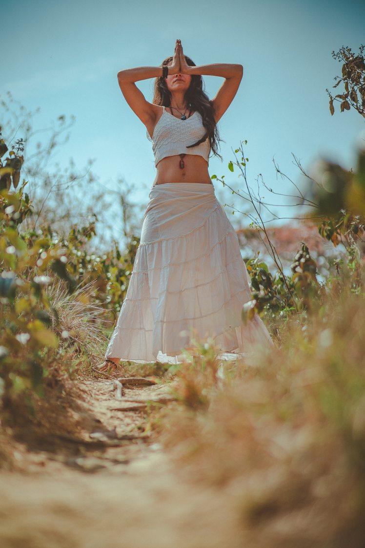 woman-in-white-tank-crop-top-on-grass-field-2529368
